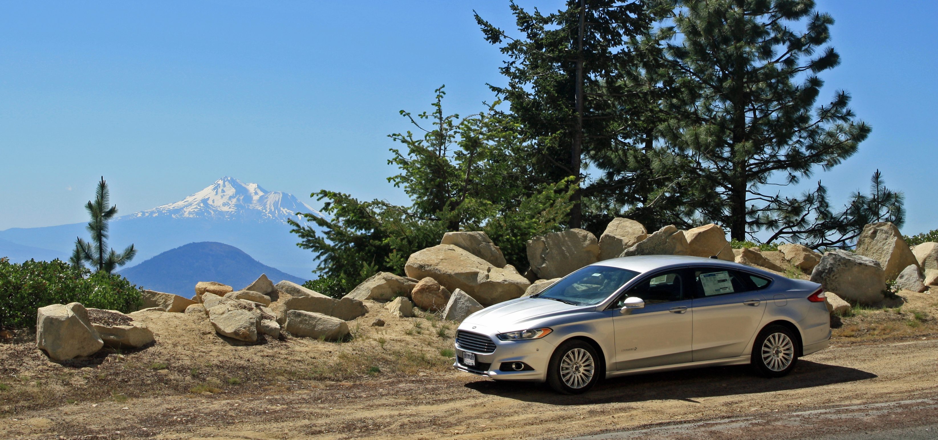2013 Ford Fusion Hybrid with Mt. Shasta in the background.